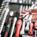 spanners-wrenches-tools-in-hands-repair-concepts-tools-box.jpg